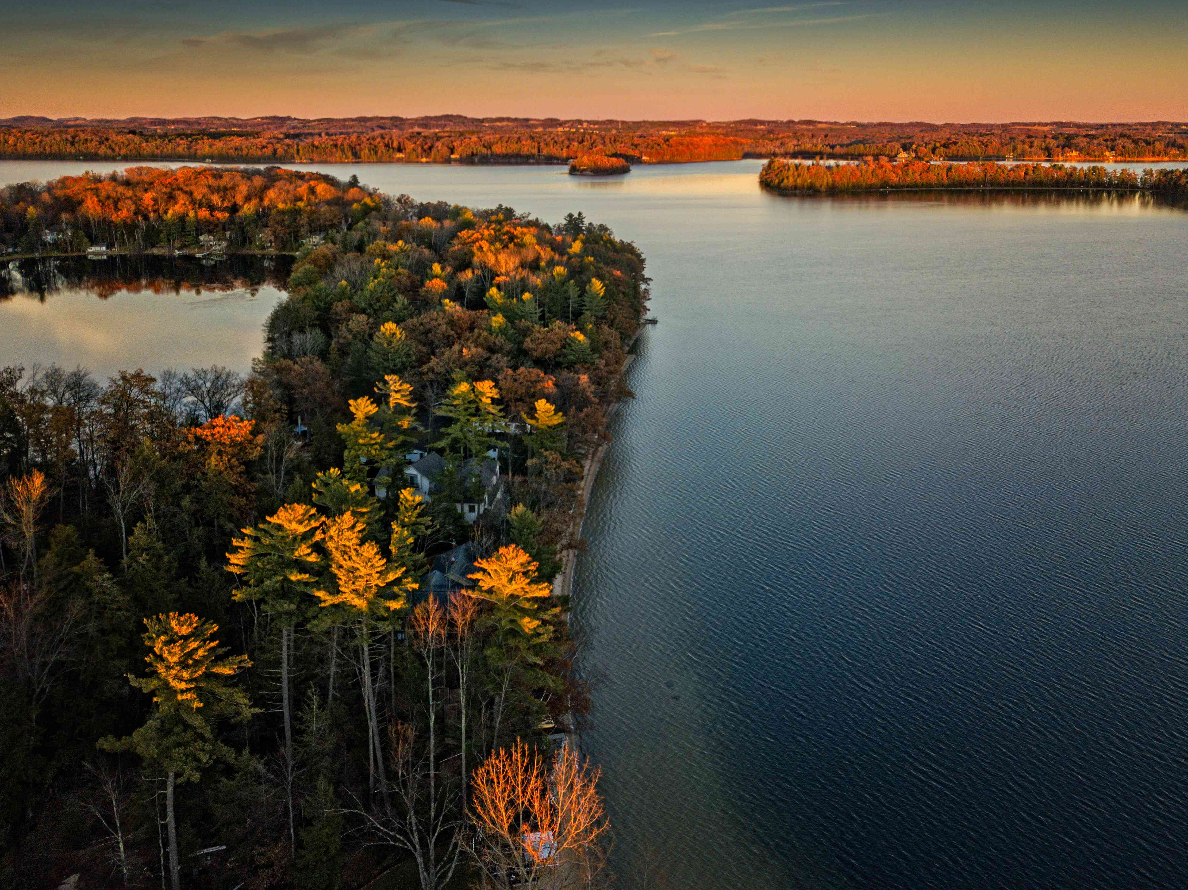 Lake Michigan surrounded by trees with colorful leaves