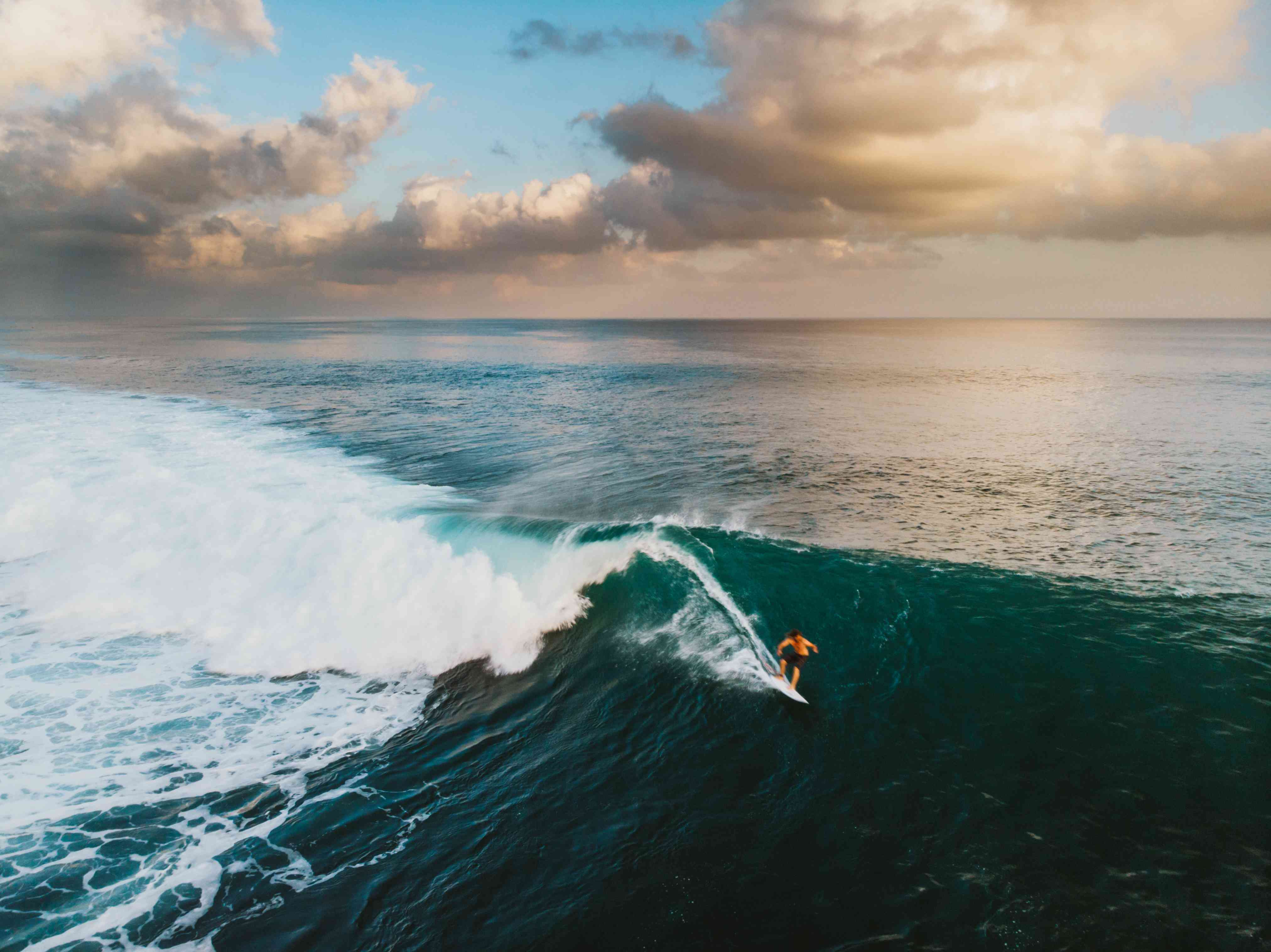 Surfer Riding a Wave in the Bali Surf Zone