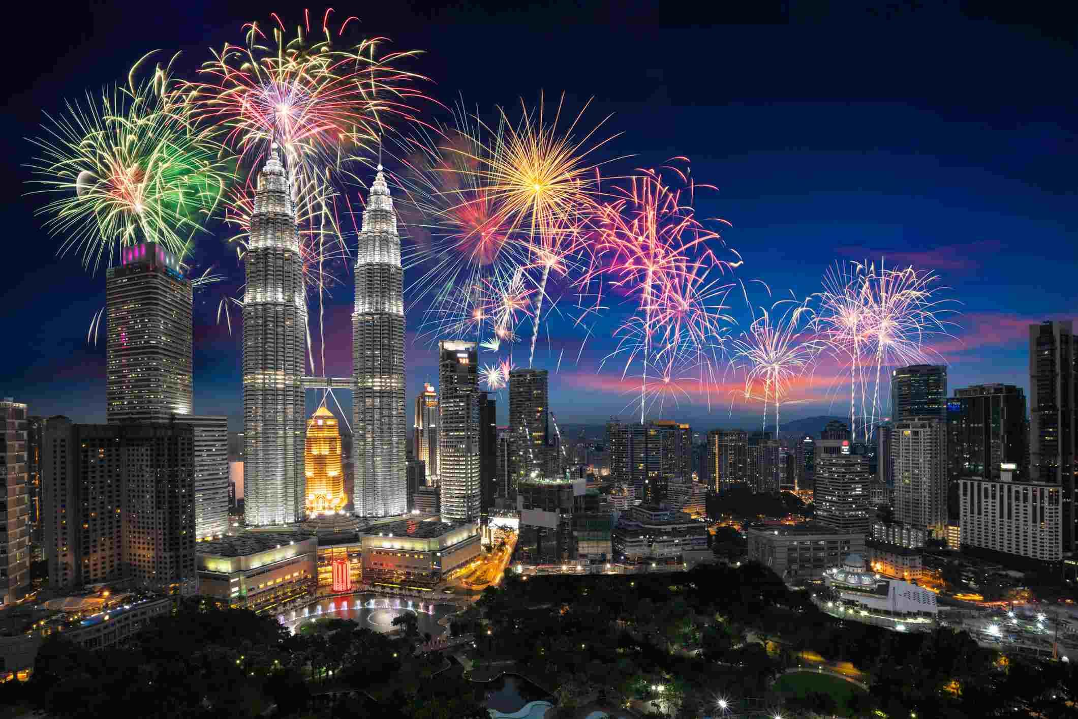 Fireworks display over skyline of Kuala Lumpur city during Hari Merdeka, Malaysia's Independence Day