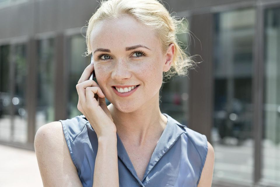 Young woman making phone call using smartphone