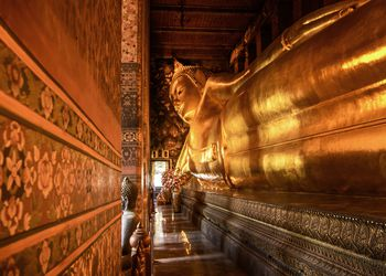 Status Of Reclining Buddha At Wat Pho Temple In Thailand