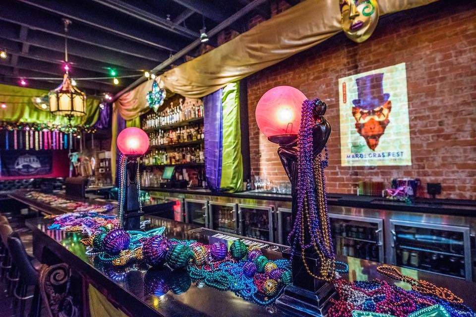 A bar decked out with beads for Mardi Gras