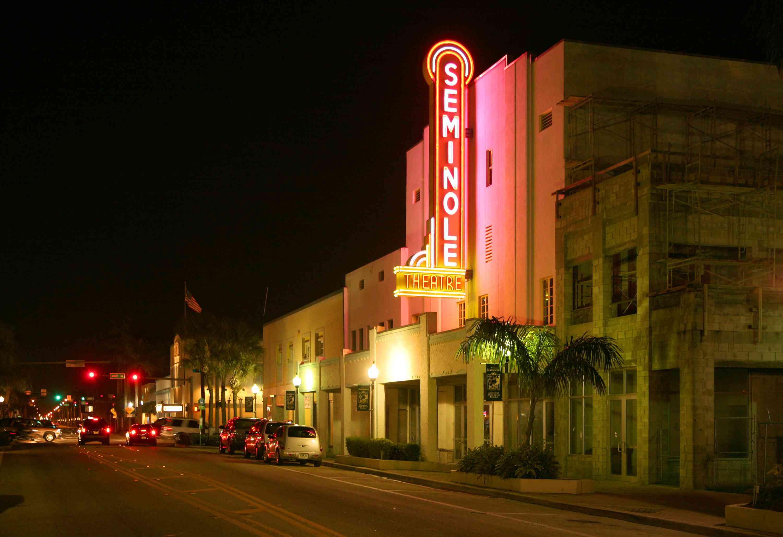Seminole Theatre neon sign at night in Homestead, Florida