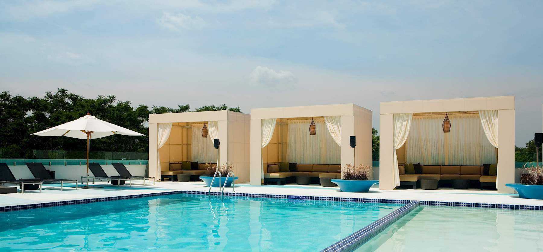 Cabanas next to an outdoor pool in Boston