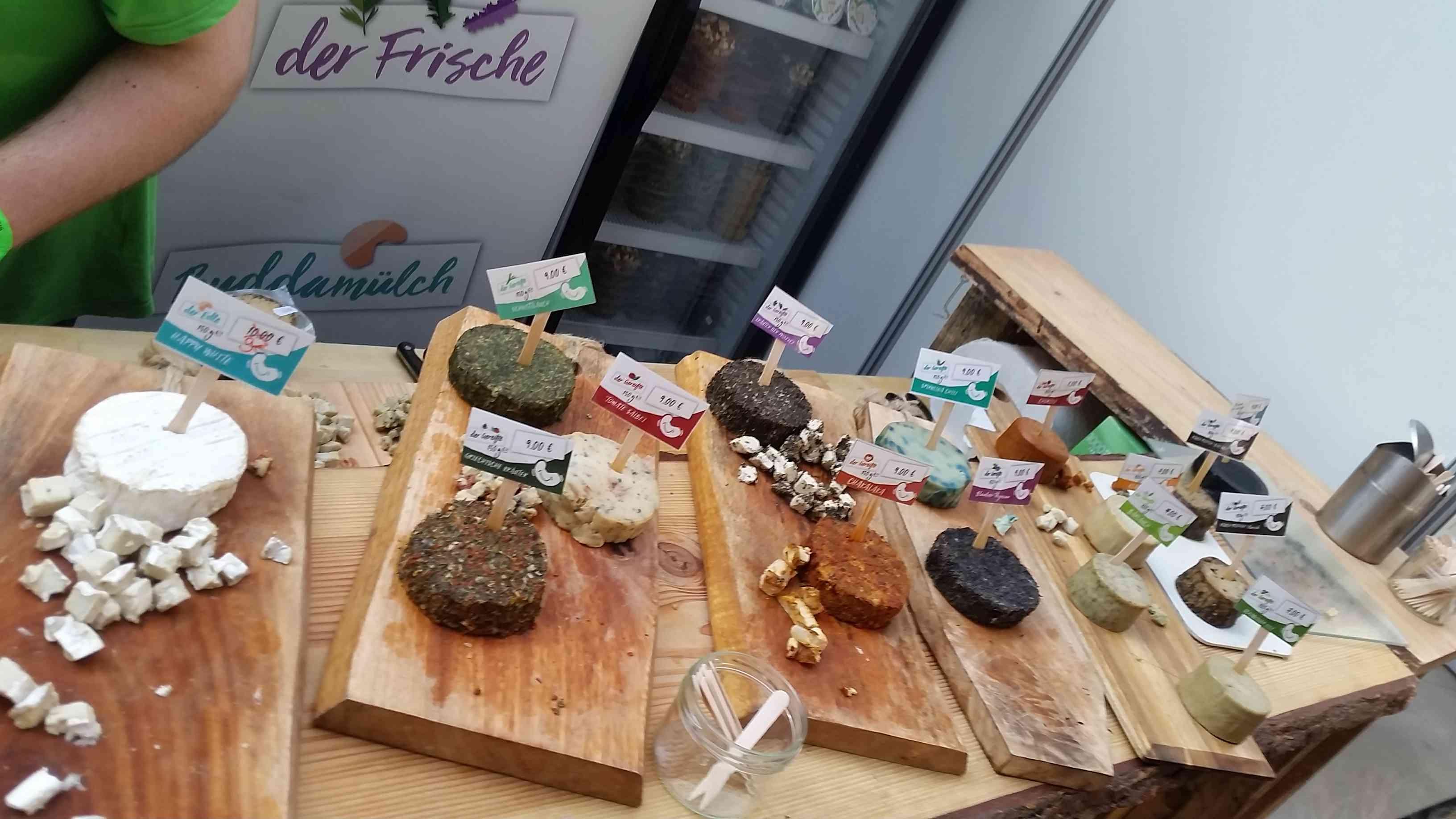 Vegan cheeses displayed at Veggie World Paris