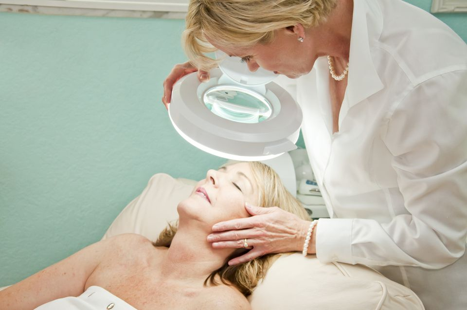 woman getting a skin analysis during a professional facial