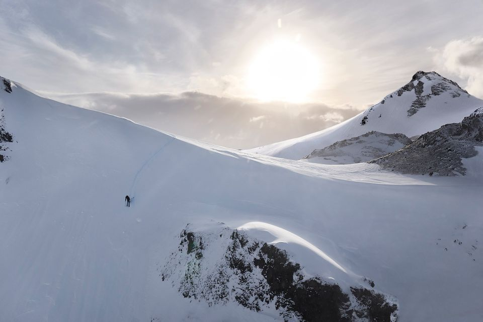Skier going down a mountain