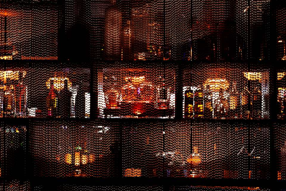 Abstract Bar Shot Of Alcohol Selection Behind Beaded Curtains in Las Vegas