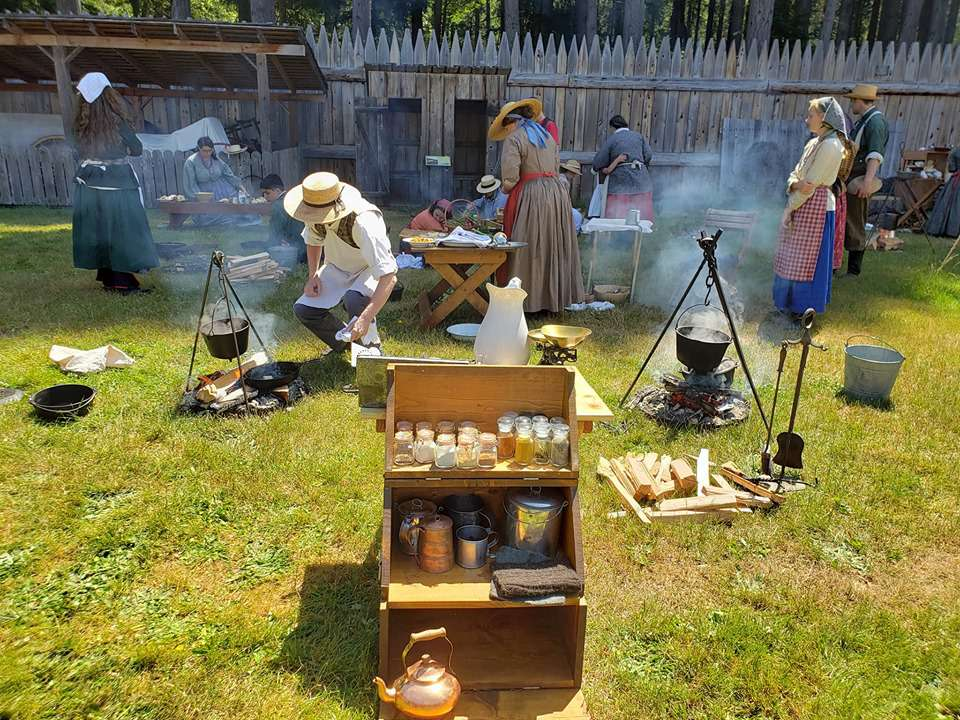People performing a reenactment and educating guests at the Fort Nisqually Living History Museum