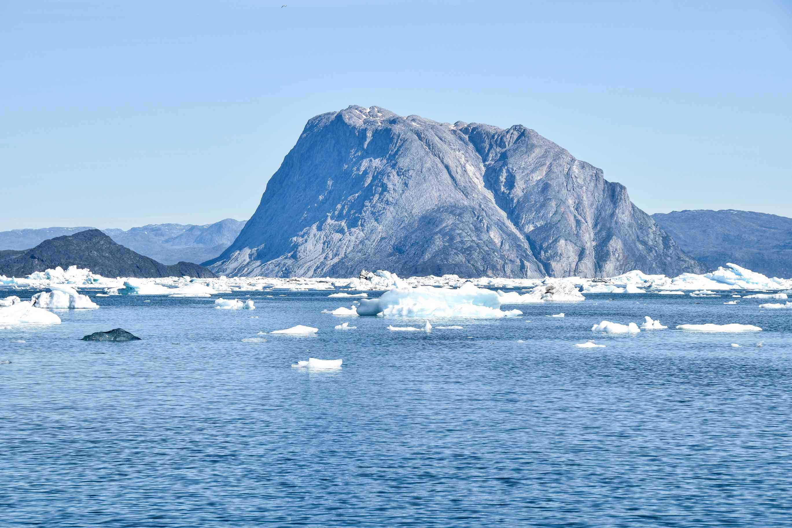 View of the arctic ocean with ice bergs in the water