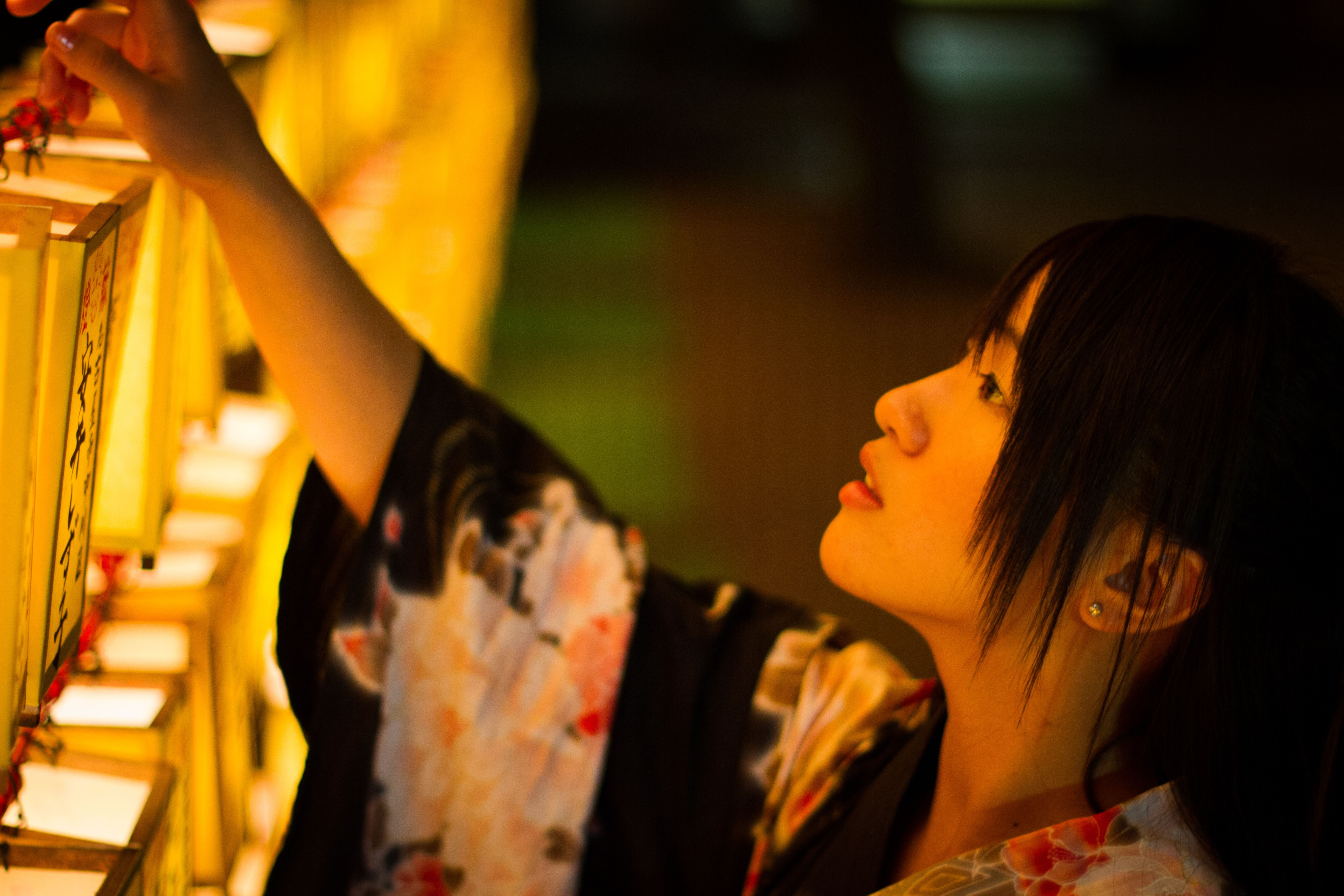 Girl making an offering during Obon in Japan