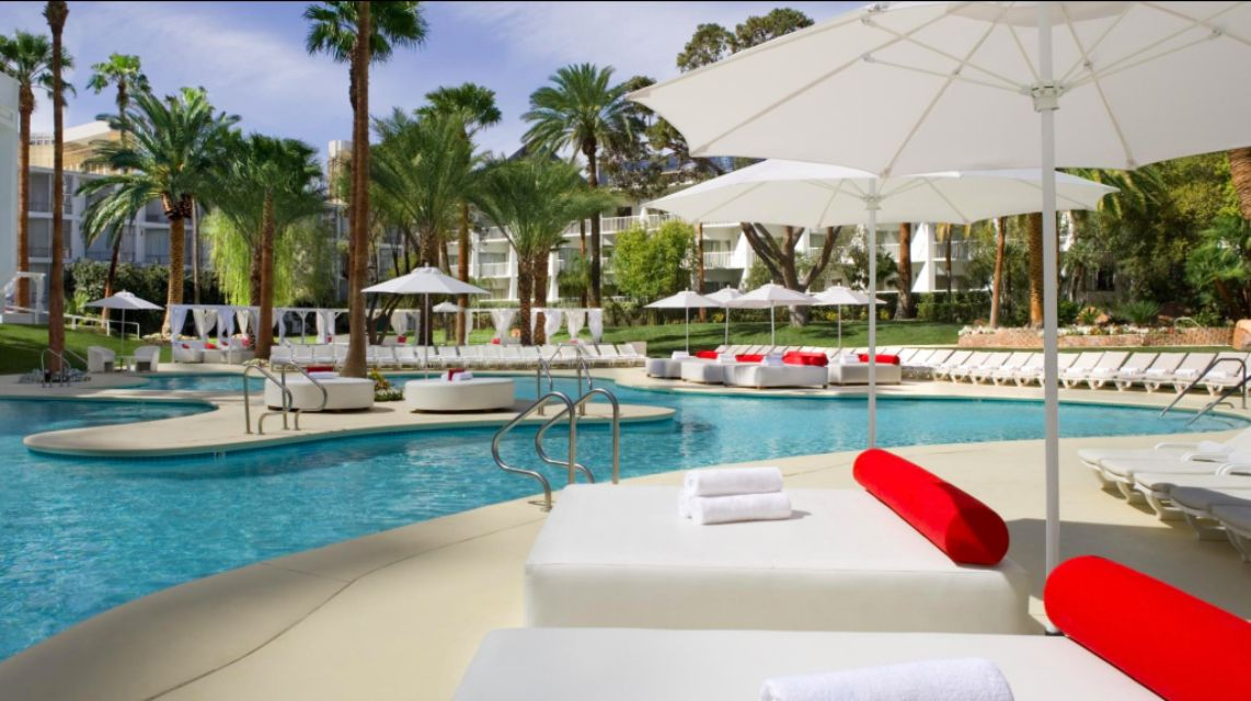 White beds with red pillows at Tropicana pool