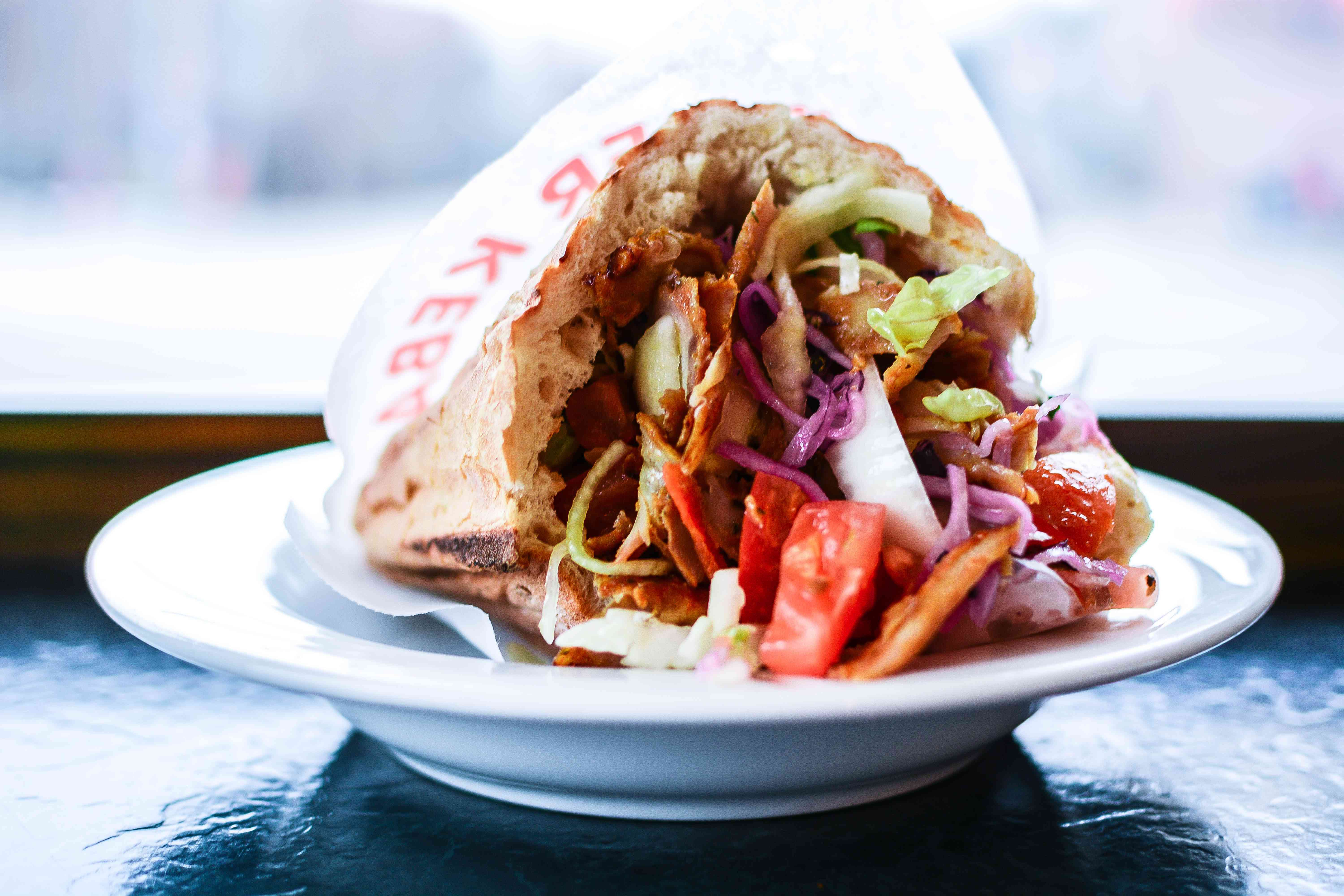 Close-Up Of Doner Kebab Served In Plate On Table