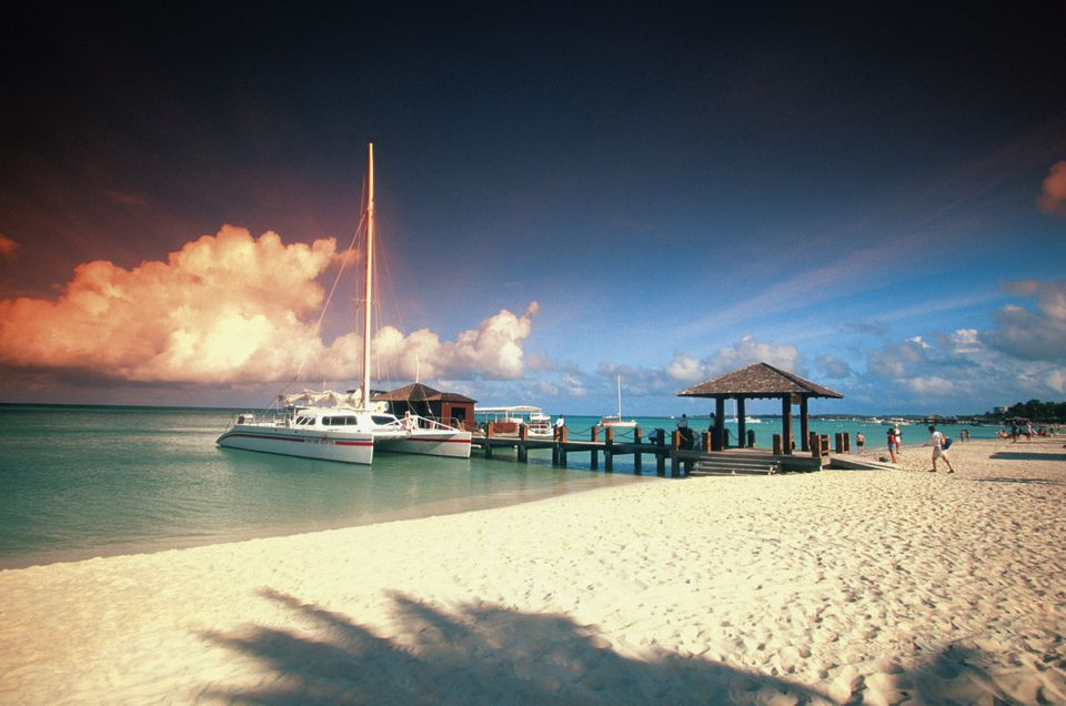 Catamaran docked at pier at sunset on Aruba, Caribbean