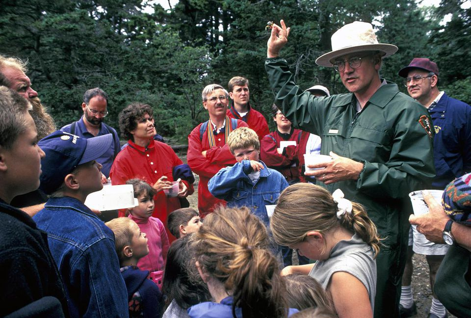 Park Ranger leading childrens field trip; Acadia National Park, Maine