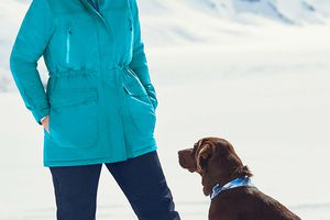 Plus-size woman in snow with dog