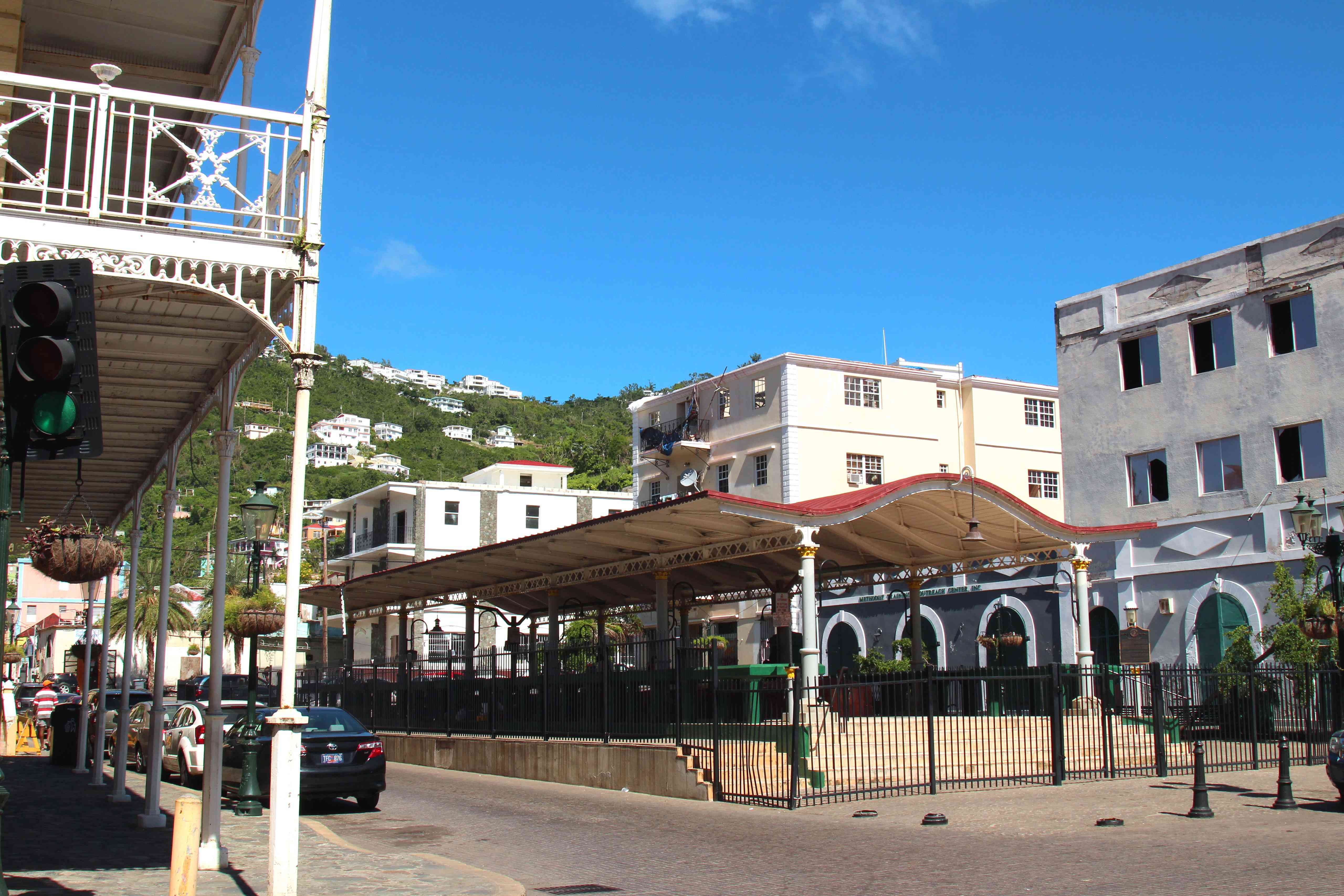 Parked cars next to a covered pavilion in St. Thomas