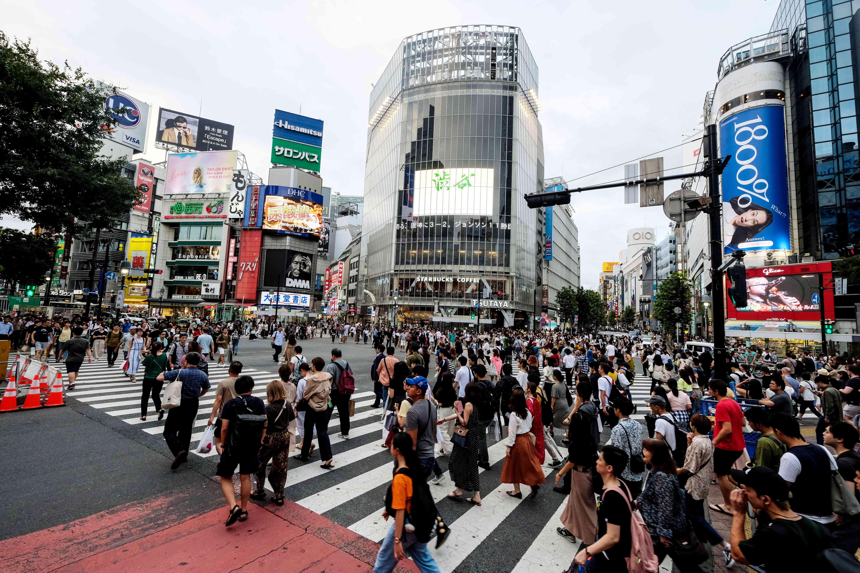 A large crowd crossing Shibuya Crossing