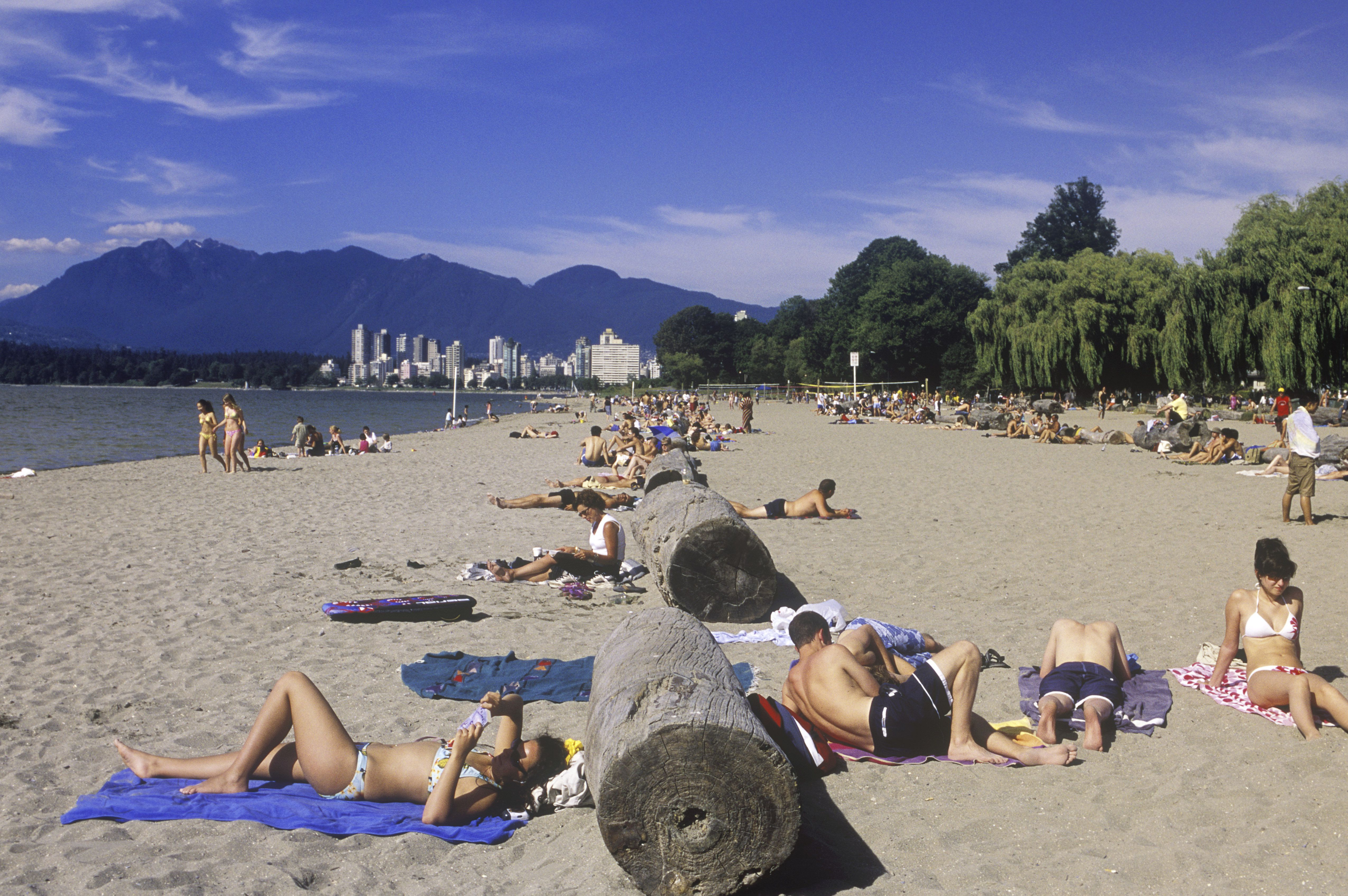 People sun tanning on Kitsilano Beach, English Bay, Vancouver, British Columbia, Canada.