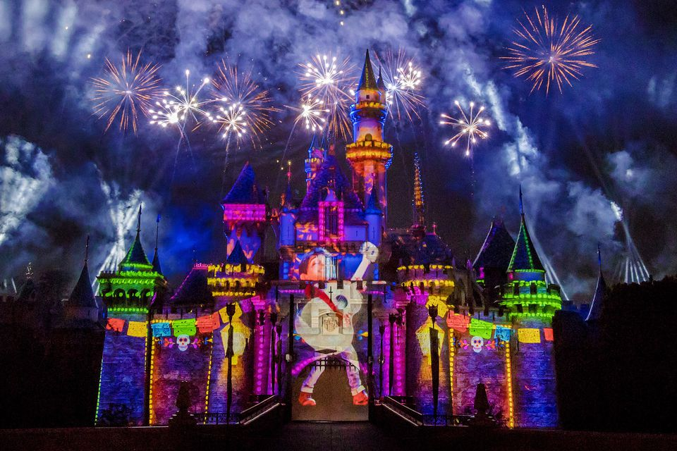 Brightly colored lights and fireworks at Sleeping Beauty's Castle, Disneyland