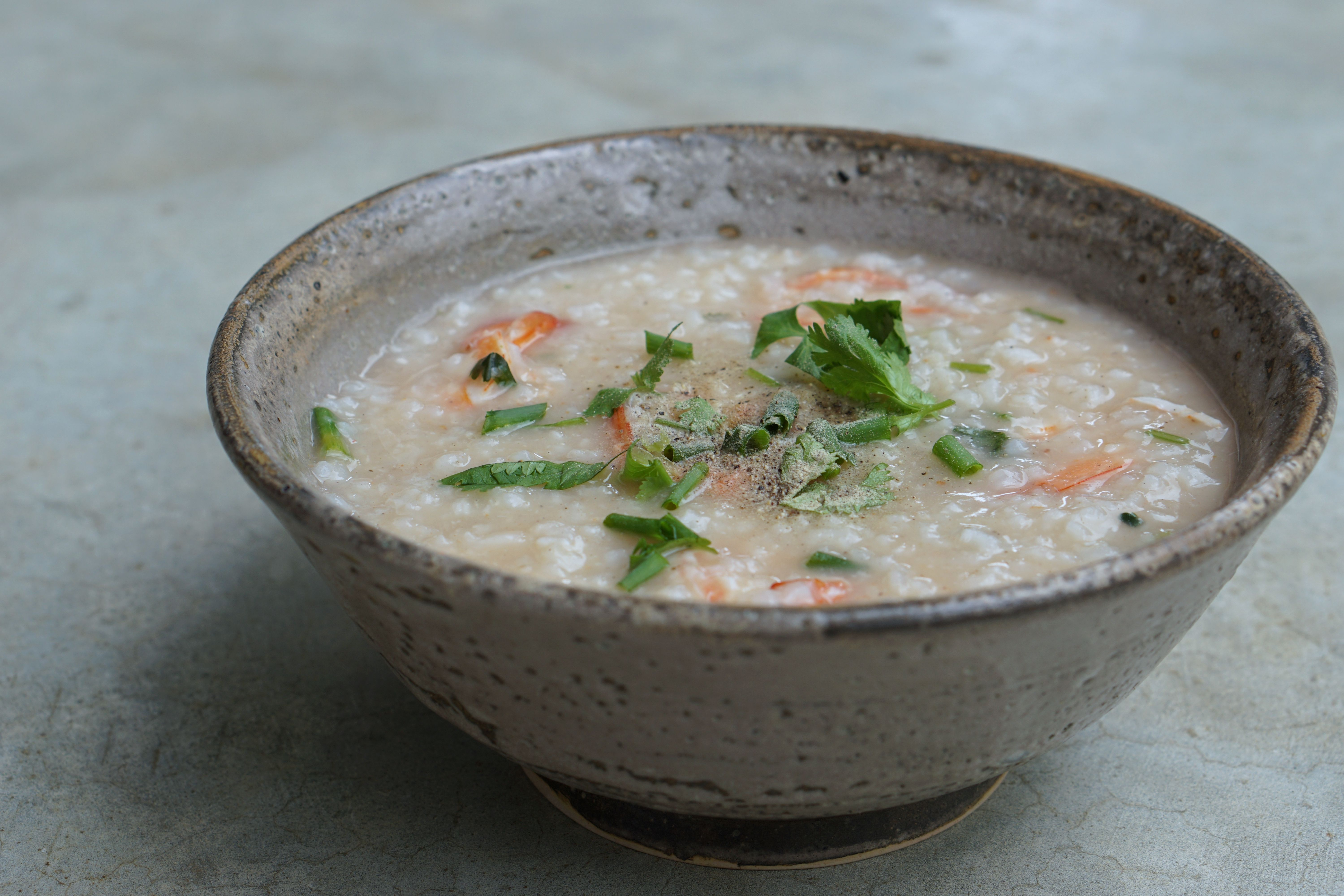 Bowl of khao tom rice soup in Thailand