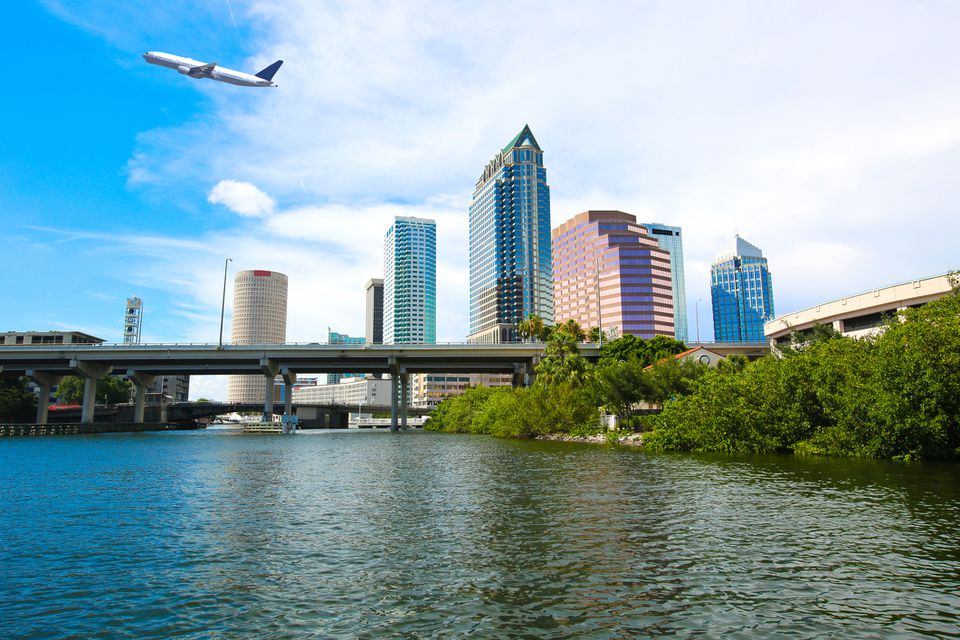 Downtown Tampa, Florida skyline with an airplane