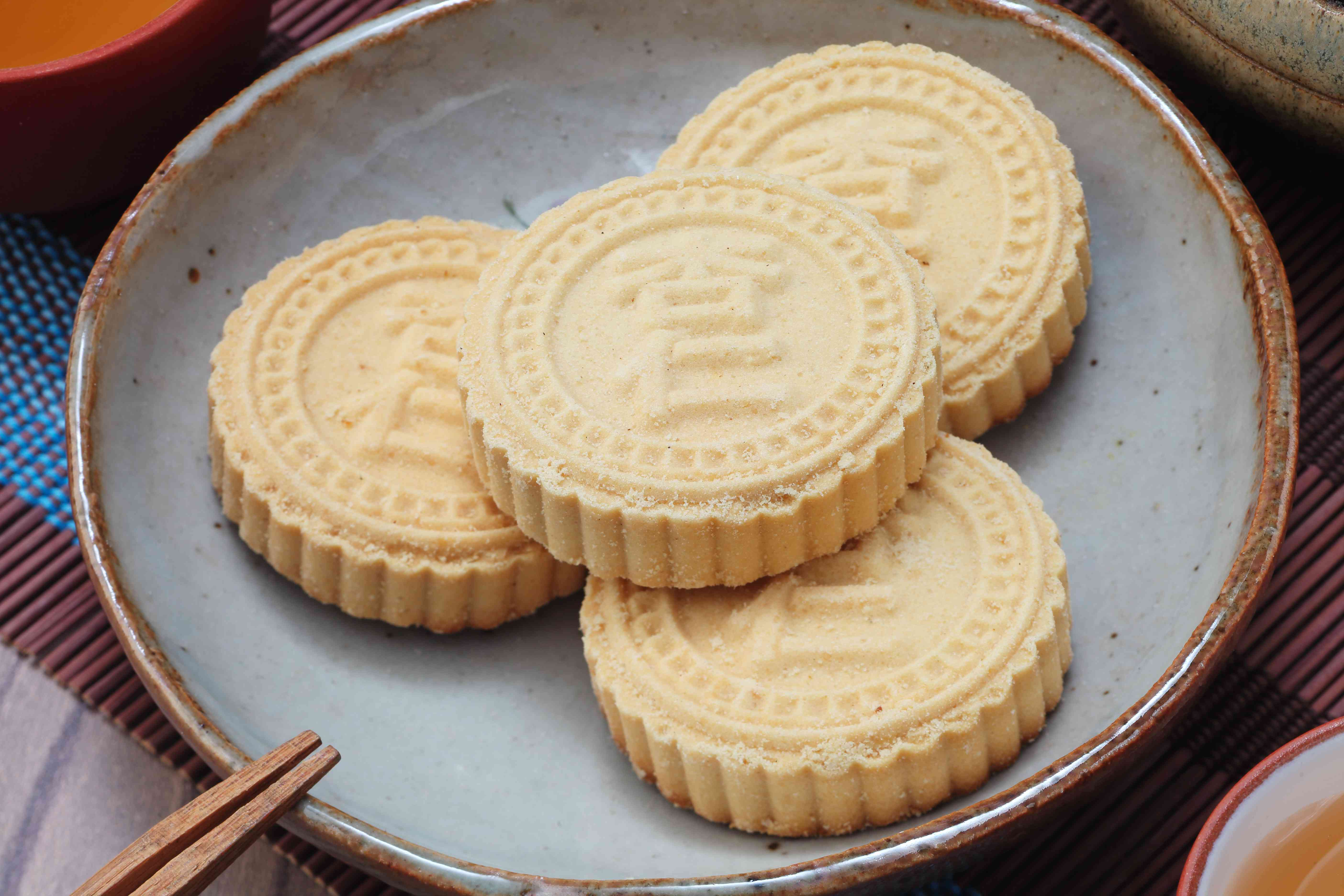 Famous Almond cookies from Macau, Chinese words on the almond cookie is 'almond', not a logo or trademark.