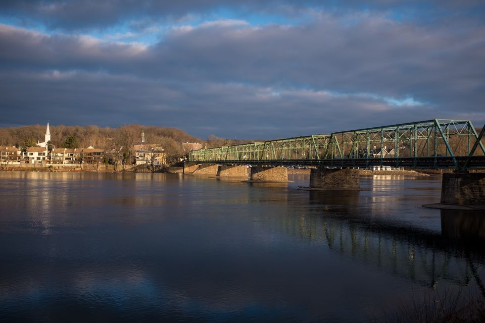 A bridge crosses the Delaware River connecting New Hope, Pennsylvania to Lambertville, New Jersey