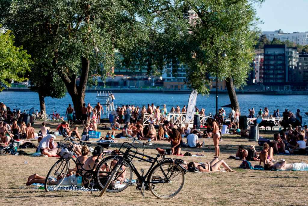 People lounging in the sun at Tantolunden
