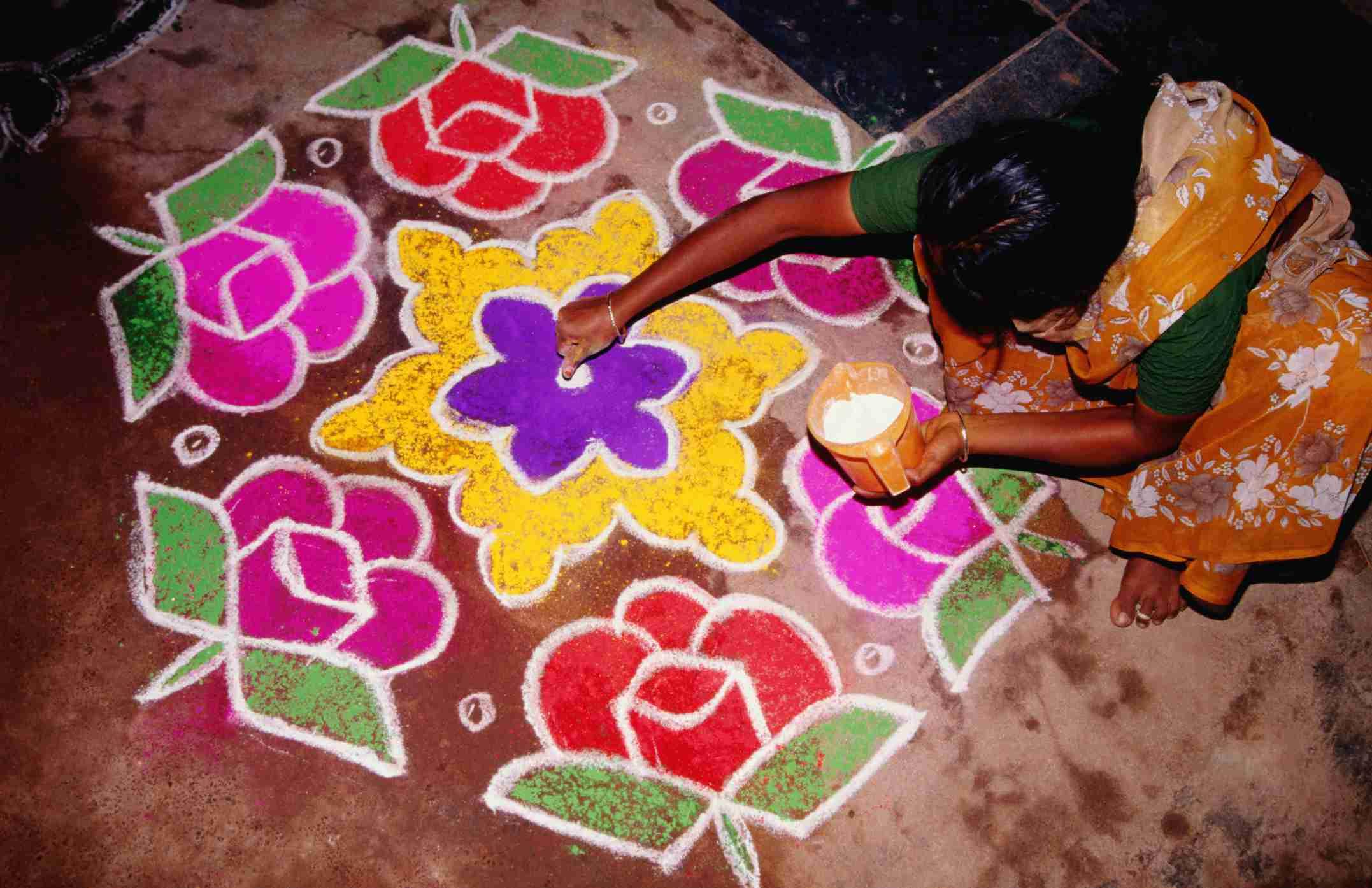 Making rangoli for Pongal.