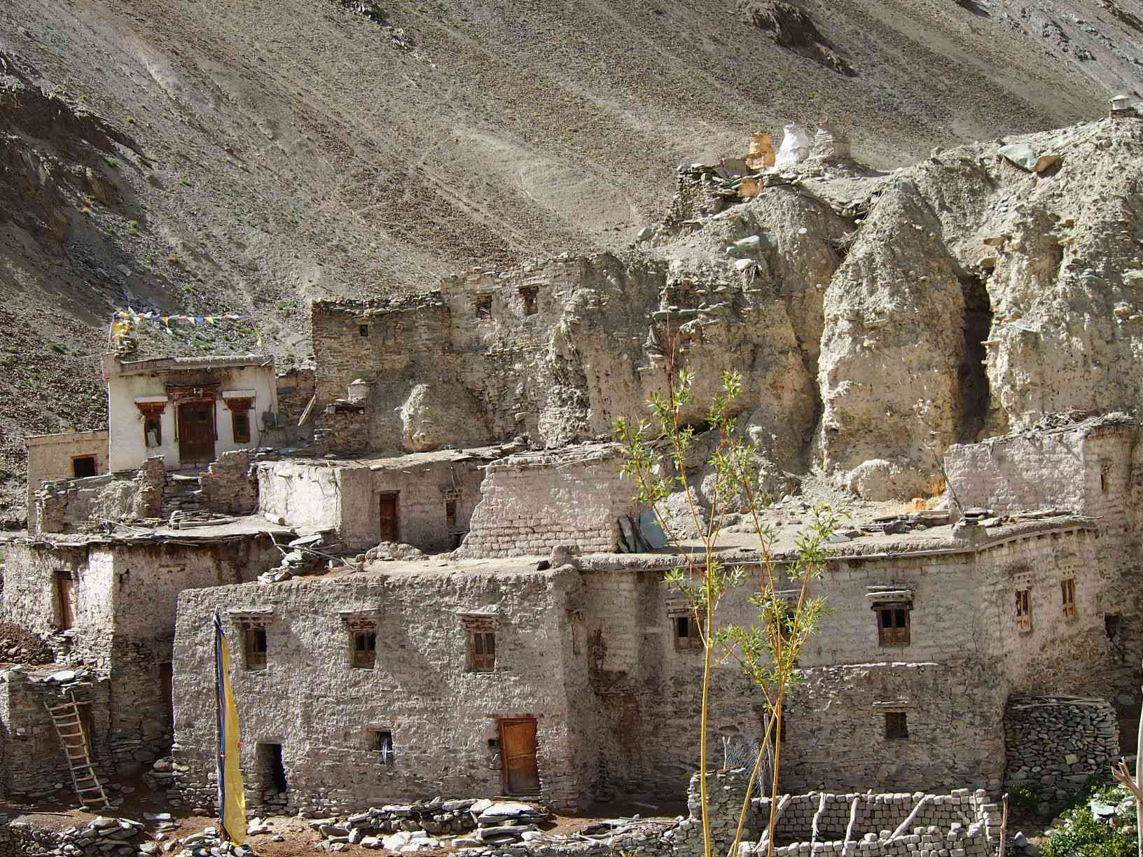 brown rock houses built into a cliff