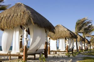Beach Paradise With Cabanas and Palm Trees, Copy Space