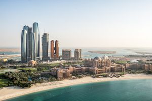 Aerial view of skyscrapers and hotels in Corniche bay in Abu Dhabi, UAE.
