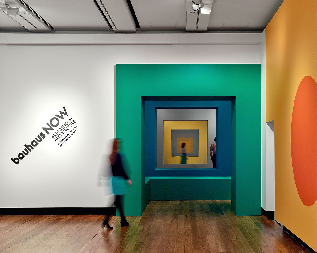 Entrance to Bauhaus exhibition with green, blue and orange geometric shapes