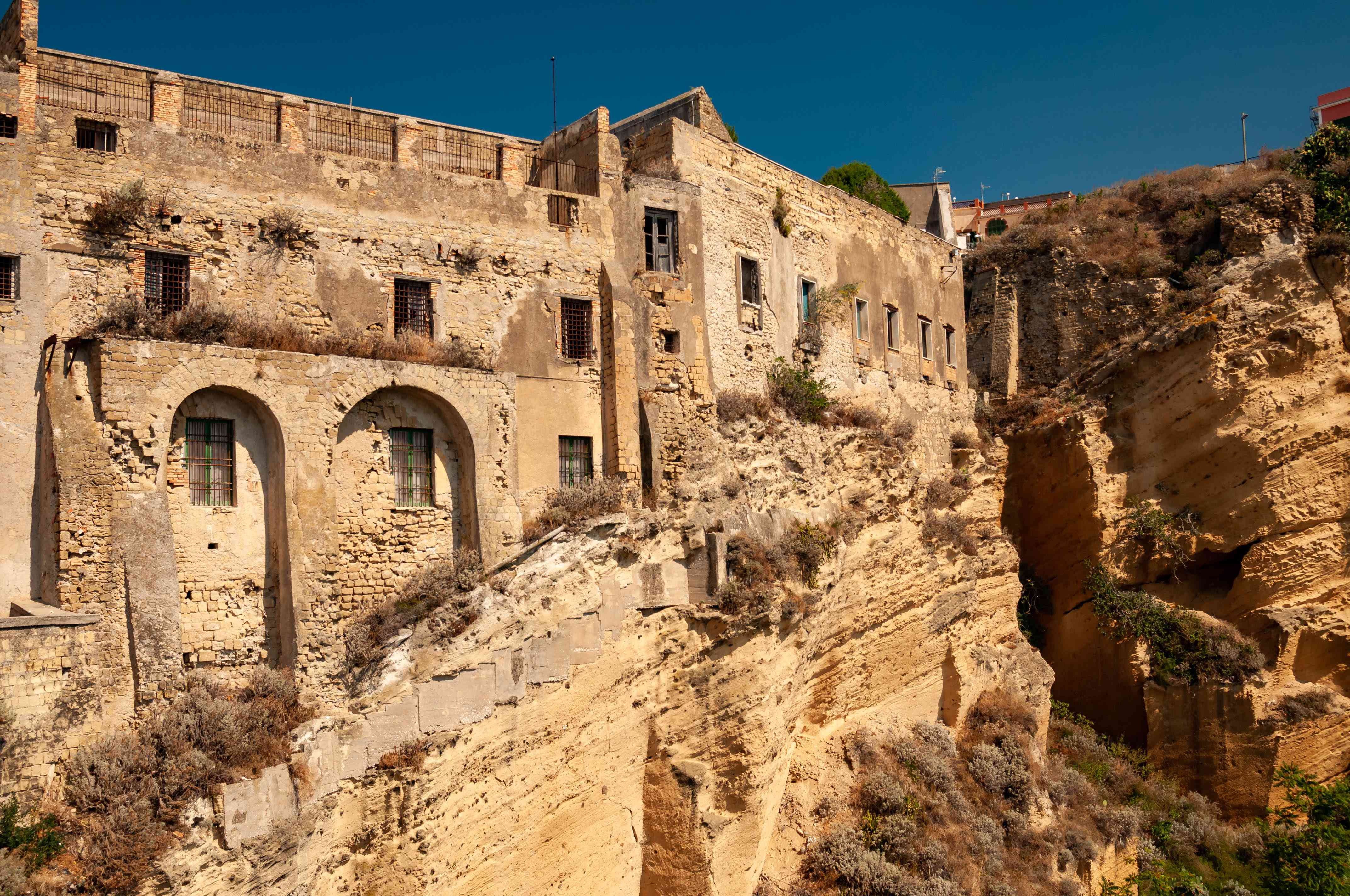 The old abandoned prison in the historic Palazzo d'Avalos on the Terra Murata cliffs, Procida Island, Italy