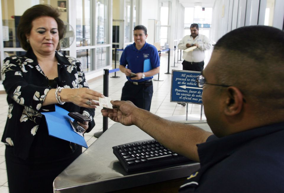 Woman showing ID at USA - Mexico Border Security