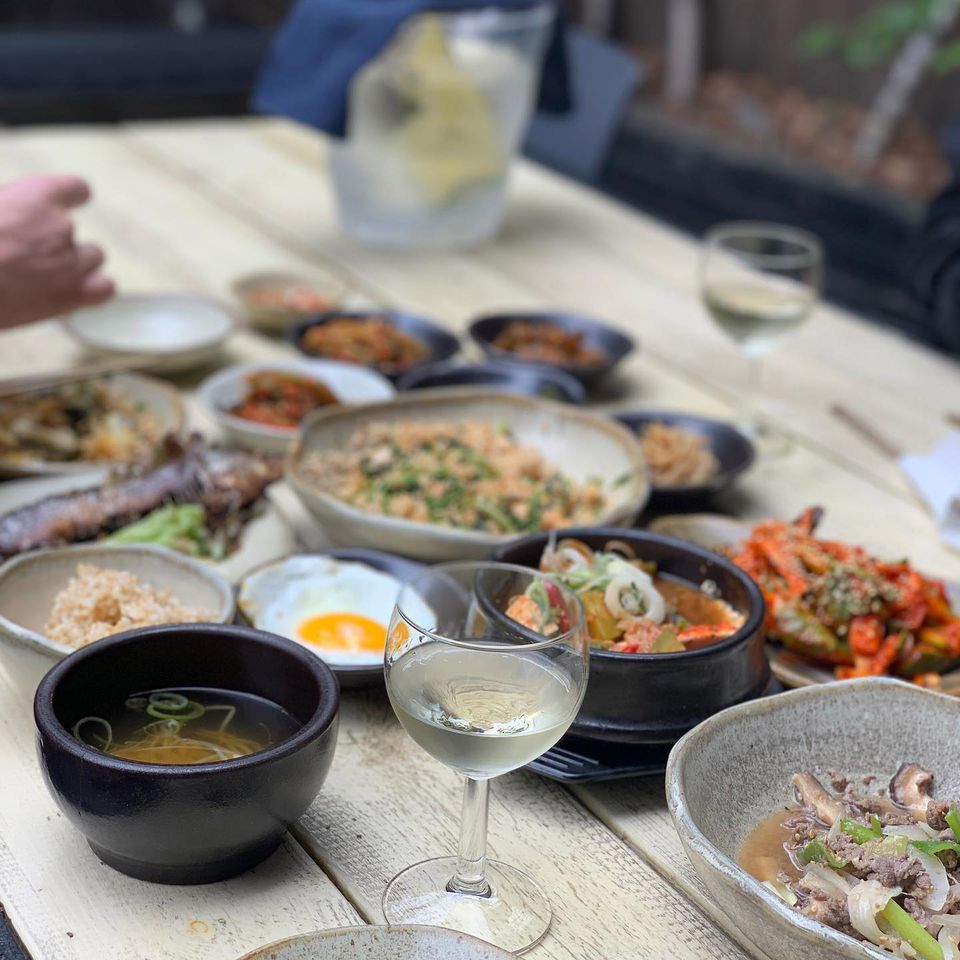 A dinner table filled with korean food and side dishes