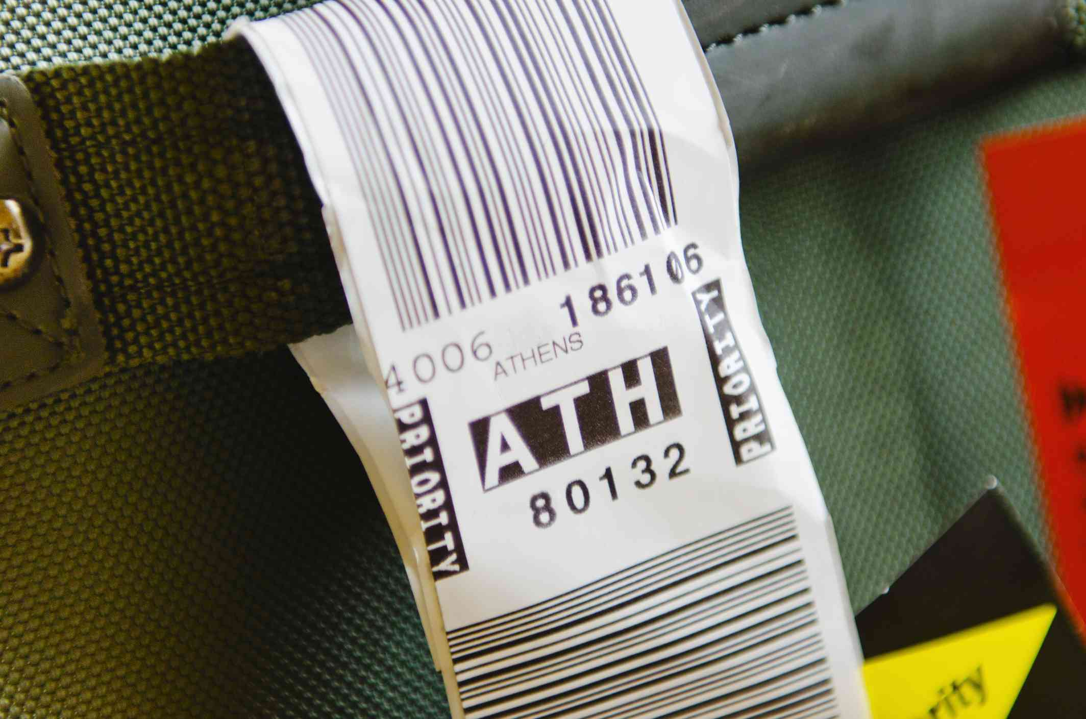 A checked bag tagged for Athens International Airport