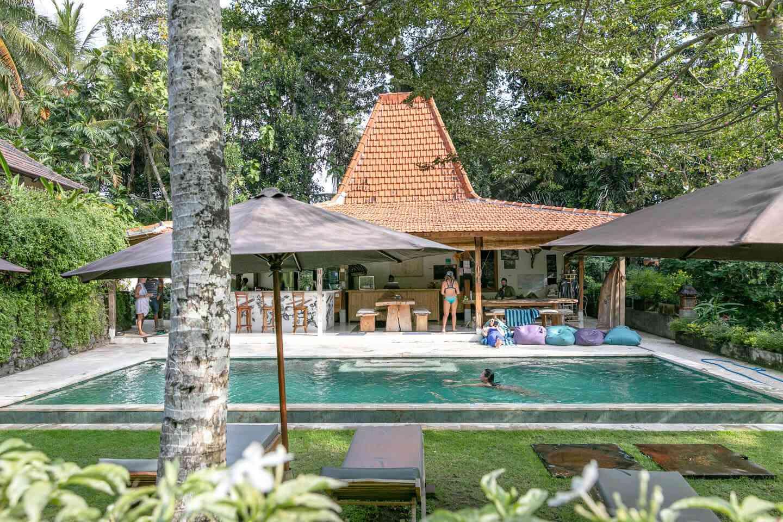 pool and beach umbrellas at the pelan pelan bali resort