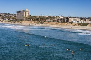 Surfers waiting in the waters of La Jolla for the next big wave, in California