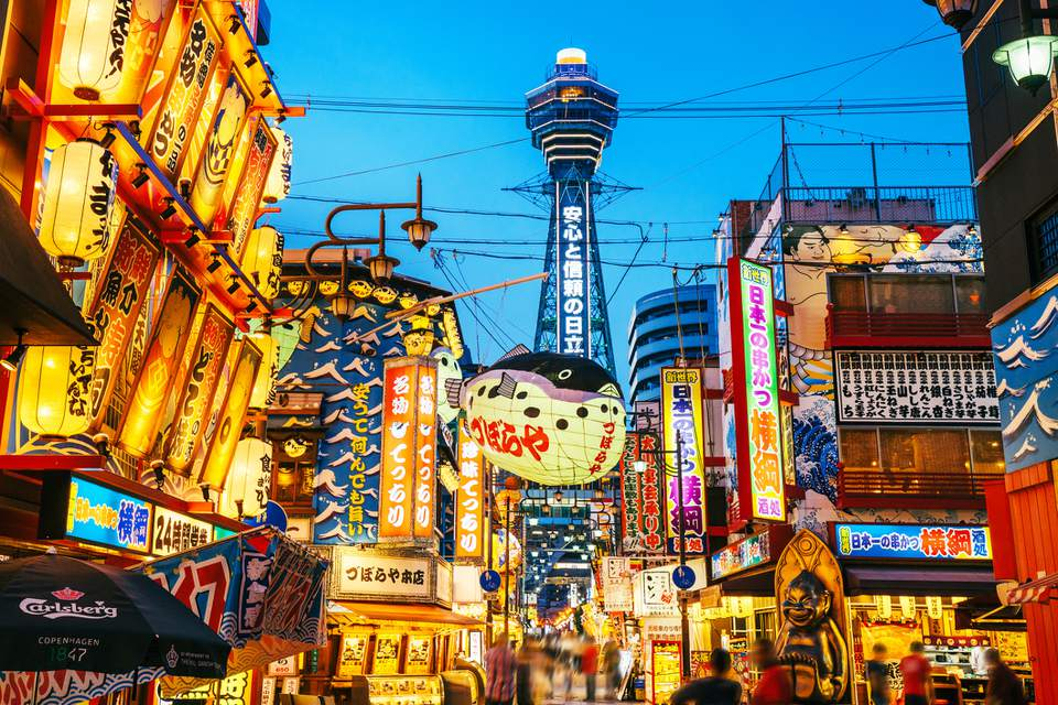 Osaka Tower and view of the neon advertisements Shinsekai district