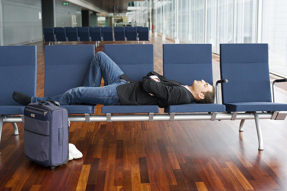Man sleeping in airport