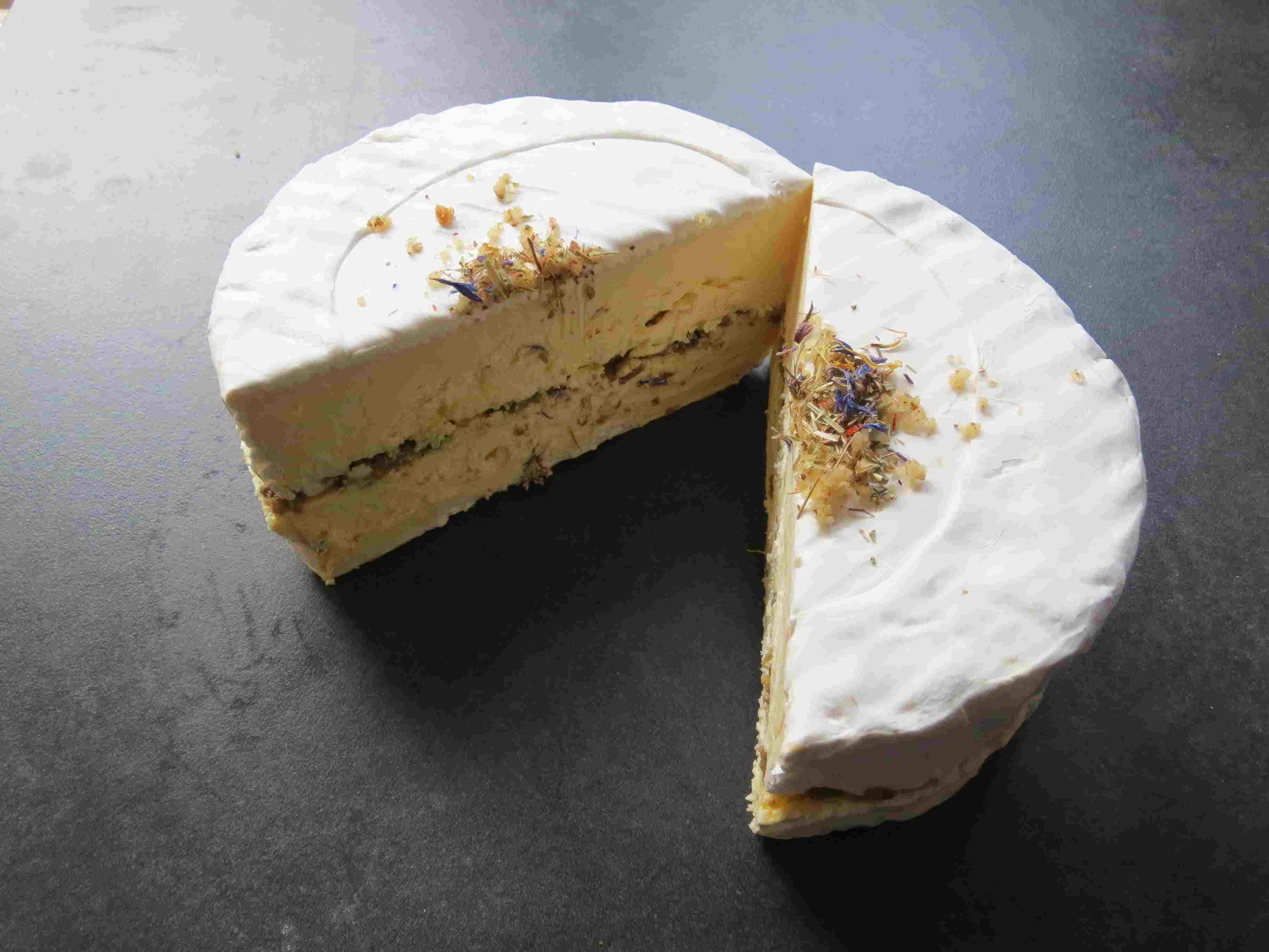 Truffle cheeses are a house specialty at the Fromagerie Hardouin-Langlet near the Marché d'Aligre in Paris.