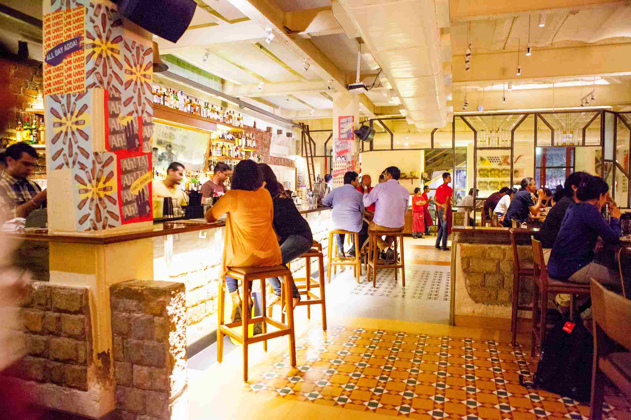 People sitting at a restaurant bar in Mumbai India