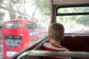 Young boy on double decker bus in London