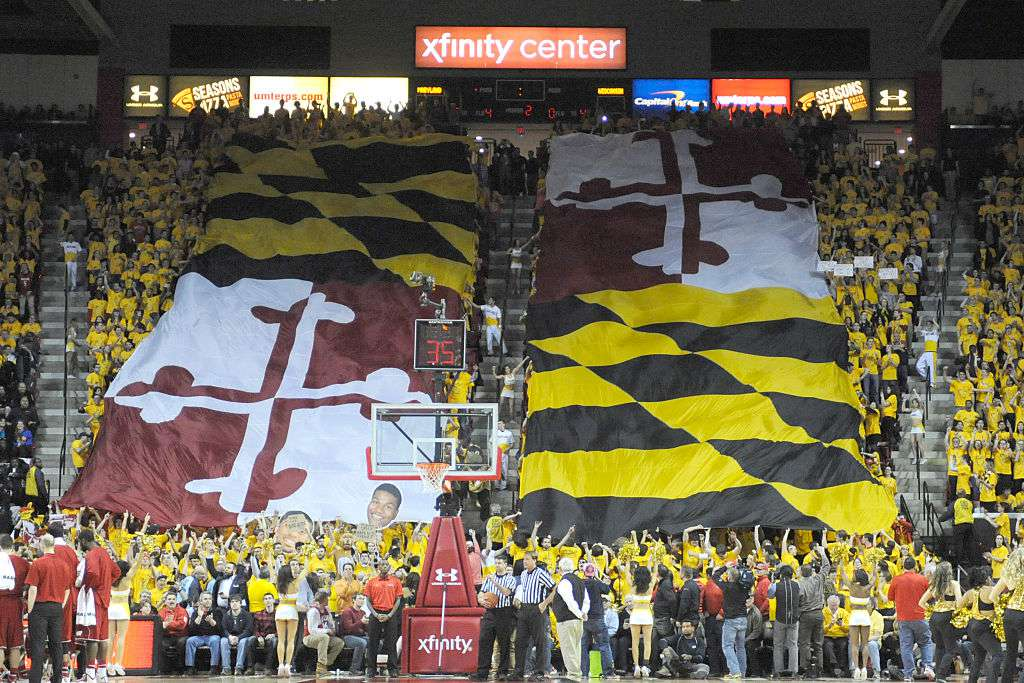 The student section rolls out the flag at a Maryland Terrapins basketball game