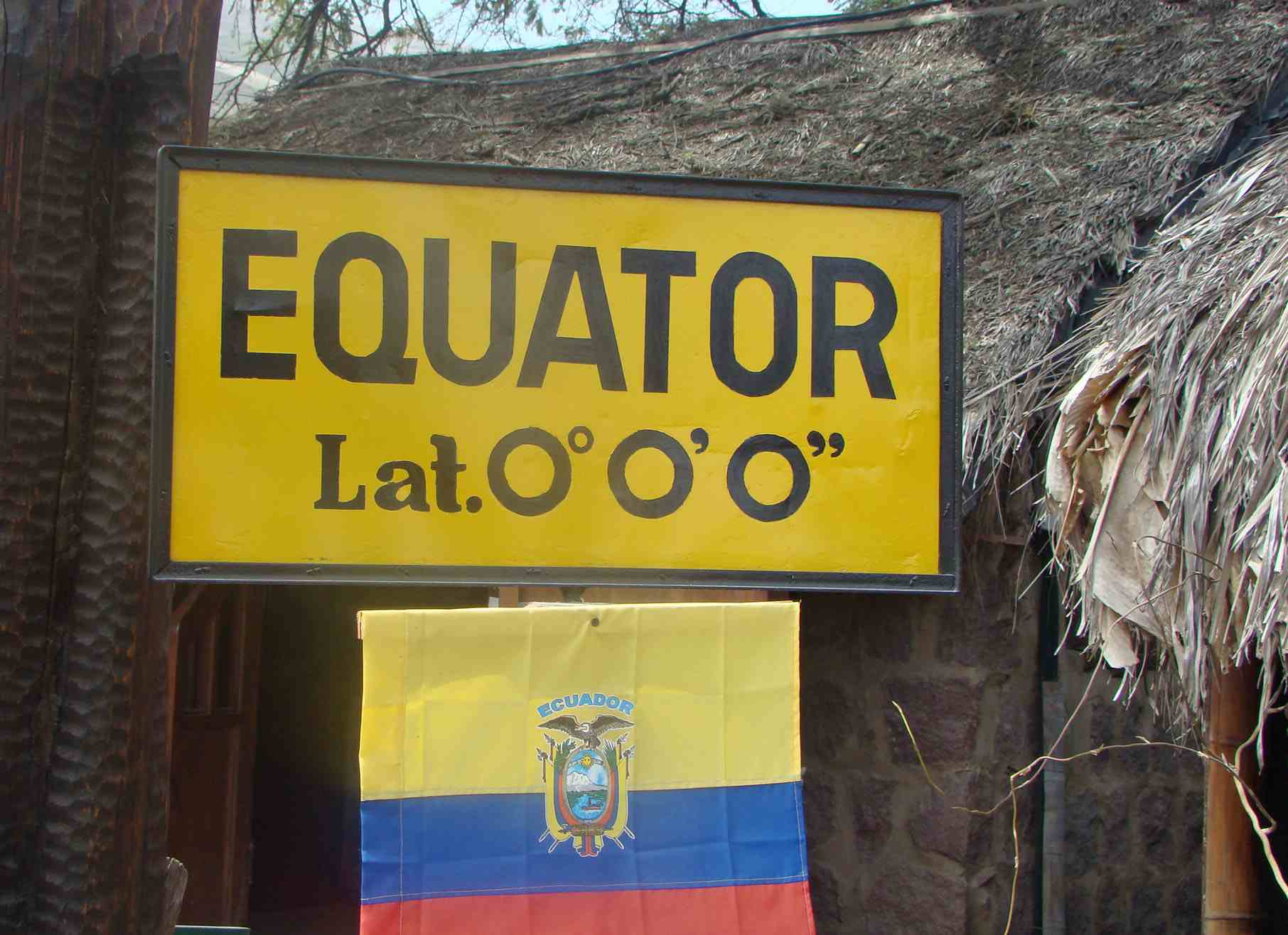 Just north of Quito, visitors stand on the equator.