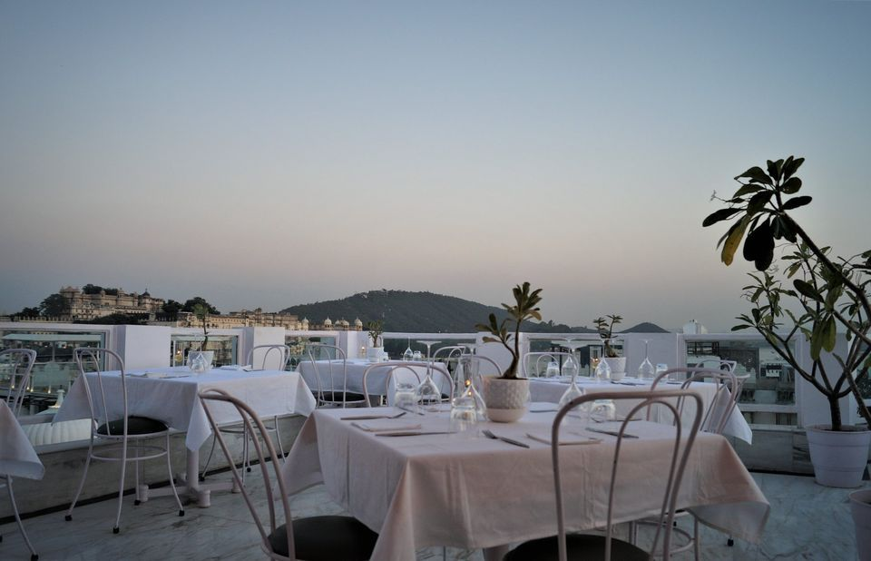 outdoor restaurant dining area with white tables