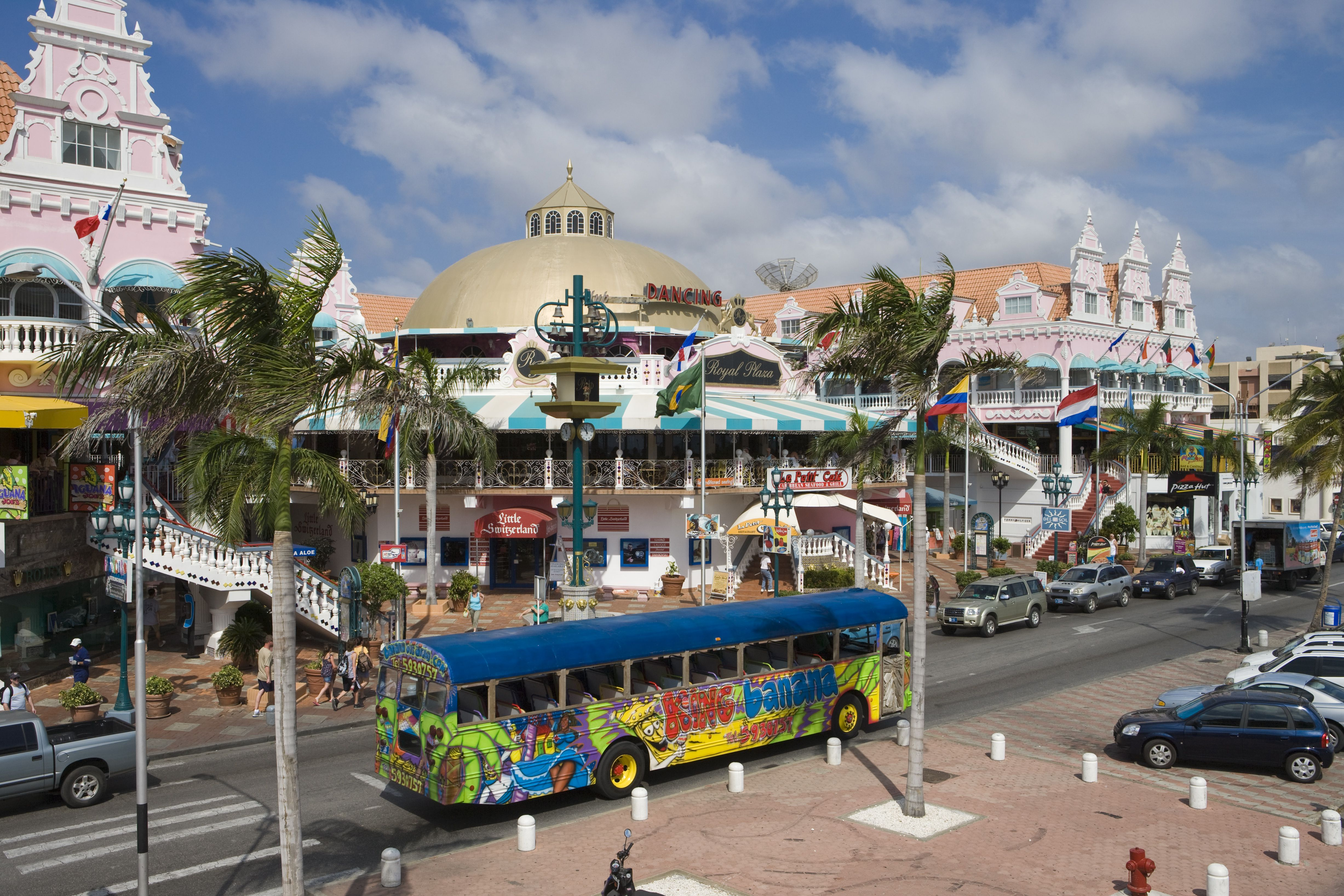 Street scene with colourful bus and Dutch influenced architecture.