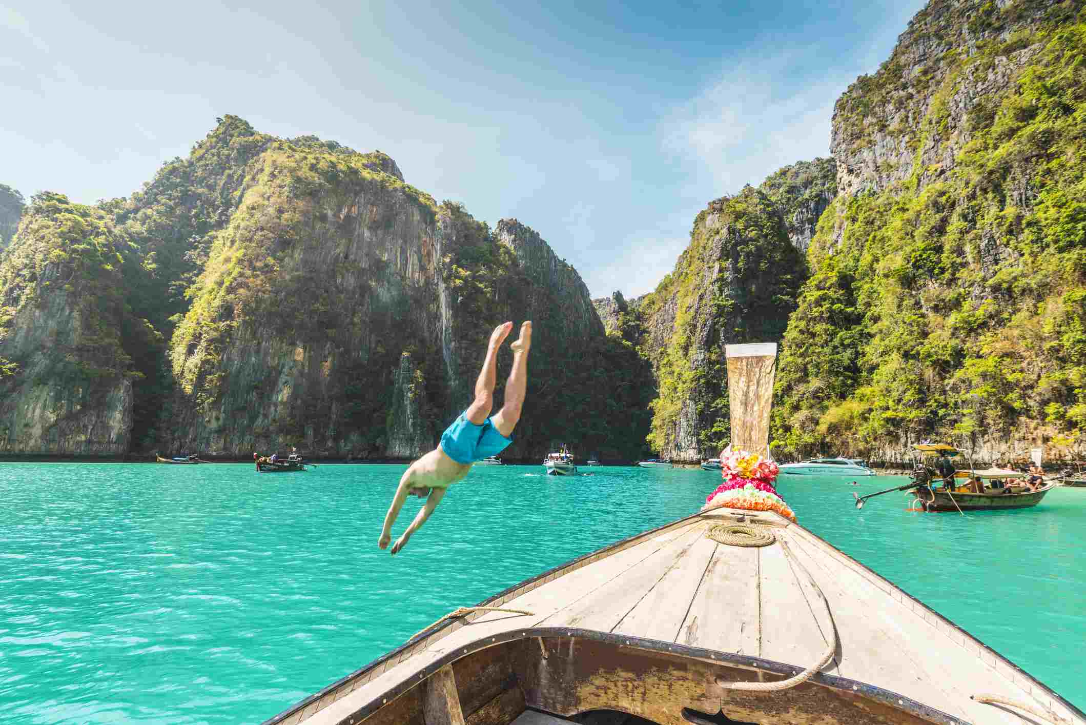 Man diving off a boat on Phi Phi Island